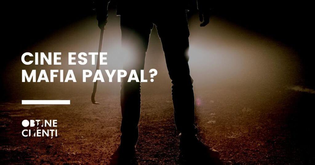 individ cu o rangă în mână într-un decor întunecat cu textul ce este mafia paypal